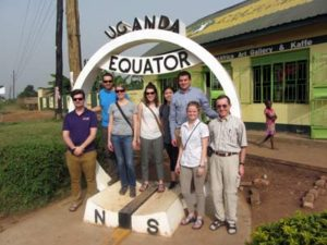 mission group in front of equator sign